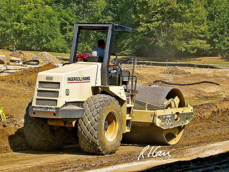 Site construction: Ingersoll Rand SD-100 single drum vibratory soil/ asphalt compactor/ roller. Huron Village Shopping Center, Ann Arbor, 2002.