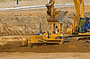Soil, earth construction: Caterpillar D4G LP dozer spreads soil in bottom of excavation. Caterpillar 345BL hydraulic excavator excavates soil from same excavation. Apparently, the bucket of the excavator has been lowered to rooof of dozer, to consternation of dozer operator. East Ann Arbor Clinic, University of Michigan Health System, Ann Arbor, Michigan 2005