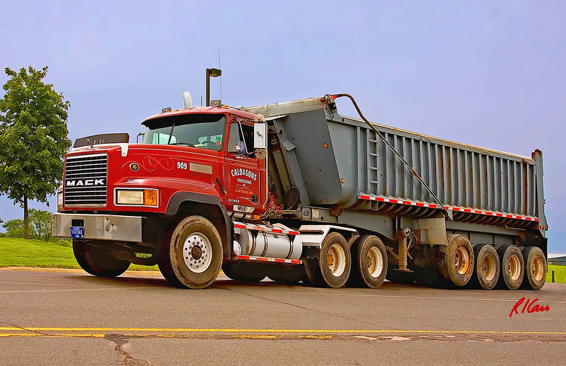 Earthmoving construction/equipment/truck: Mack CL700 truck with rear-dump bed hauls earth for construction. Earhart Road, Ann Arbor, Michigan 2006.