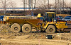 Construction equipment: Caterpillar D250E 25 ton, articulated, rear dump, rough terrain, off road hauler. Plymouth Green Crossings, Ann Arbor, Michigan, March 2007.