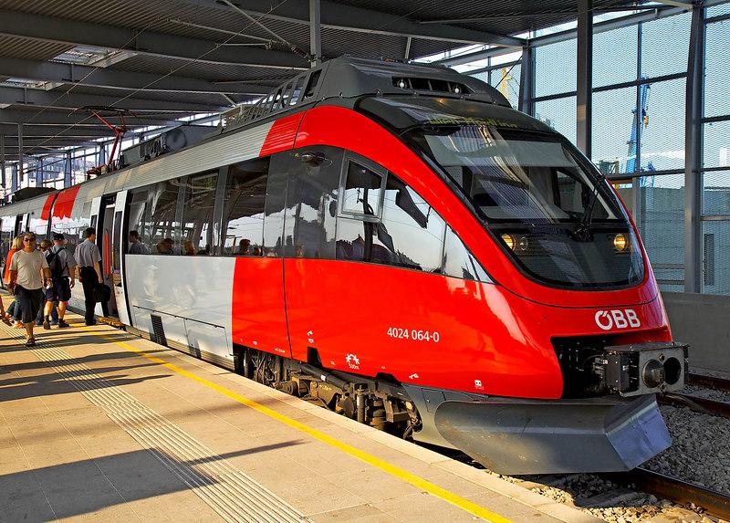 Passengers board train at Praterstern train station, Vienna, Austria. July, 2006.