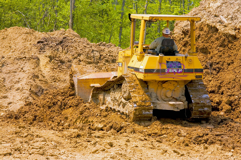 Caterpillar D4H XL bull dozer moves earth at site of new North East Branch Library, Ann Arbor, Michigan, May, 2007