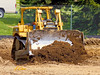 Caterpillar D6R bull dozer moves earth to rough grade path of scraper excavating earth. The Courtyards private dormitory, North Campus, University of Michigan, Ann Arbor, Michigan. 2007.