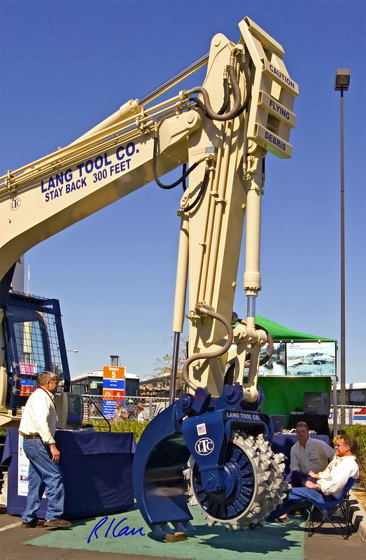 """Site development/remediation/landscape construction: Lang Tool Co. (LTC) 37 ton tracked excavator based """"tool carrier"""" for rotating stump grinder, mower, in-situ blender, and rock grinder heds. CONEXPO, Las Vegas, Nevada, March 15-19, 2005."""