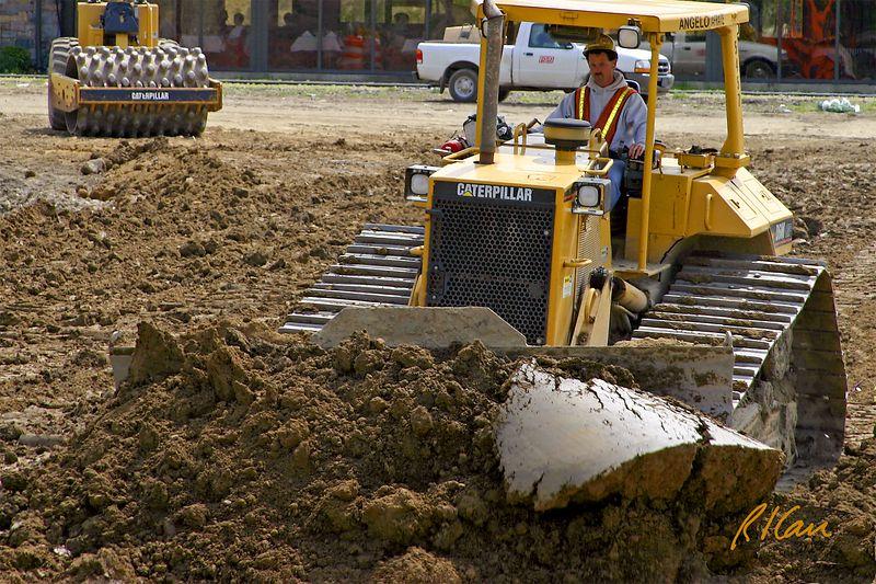 Caterpillar D6M 140 horsepower, 15.5 ton crawler tractor construction bulldozer. Broadway Bridge construction, Ann Arbor, 2003.