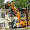 Building construction demolition. Samsung SE 350 LC2 backhoe grapple tears window out of building wall.  YMCA, Ann Arbor, 2003