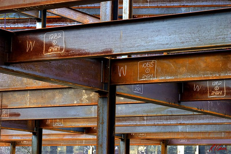 Structural steel construction/erection: Welded structural steel frame, showing raw, unpainted steel with fabrication/erection markings marked in white. YMCA, Ann Arbor, Michigan 2004. myconstructionphotos.smugmug.com