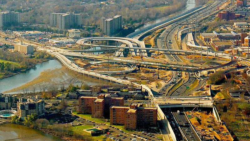 Airplane view of construction of interchange between Route 1 and Capital Beltway US 95/495 with scheduled completion in 2008. Route 1 is East/West, shown horizontal in photo and US95/495 is North/South, shown vertical. Part of Woodrow Wilson Bridge project. Alexandria, Virginia, November, 2006.