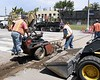 Asphalt construction: Ditchwitch small trenching machine below pavement-3