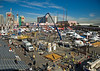 Concrete/masonry construction: Outside exhibits of concrete placement, distribution, screeding, textures, finishing. Demonstration area with grandstand is at lower left.  World of Concrete/Masonry, Las Vegas, Nevada January 2006