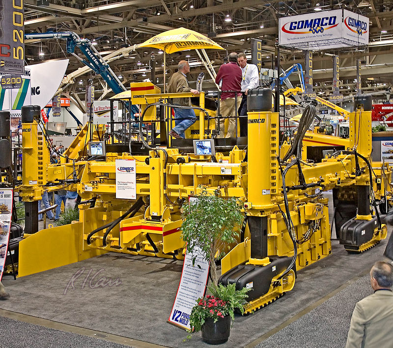 Concrete/masonry construction: Gomaco V2 paving mold for slip-forming concrete pavements. It is hydraulically adjustable dual mold for various paving widths, including varying widths and curbs on either side. World of Concrete/Masonry, Las Vegas, Nevada January 2006