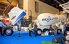 Concrete construction: OshKosh concrete ready-mix truck with McNeilus mixer drum. Oshkosh rear-drive engine hood is open for inspection by attendees. World of Concrete/Masonry, Las Vegas, Nevada January 2006