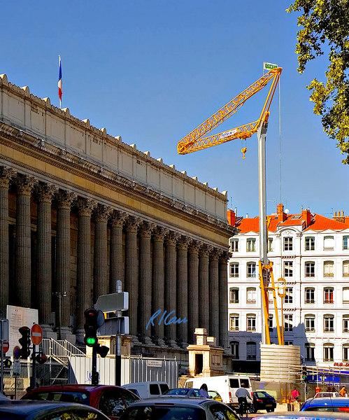 Construction crane, demolition: Potain tower crane removing debris in demolition of front steps of Palace of Justice. Lyon, France September 2006.