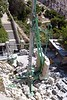 Construction crane: Base of Potain compact self-erecting tower crane on Cathedral de la Major in Marseilles, France, showing counterweights on right.