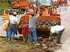 Brick pavement construction demolition: Laborers are manually loading uprooted brick pavers into bucket of Daewoo Mega 250 III front end loader-2. Depot Street, Ann Arbor, 2004.