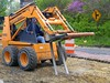 Brick pavement construction demolition: Case 1845C skid steer tractor with forklift attachment breaks up pavement base material. Depot Street, Ann Arbor, 2004.