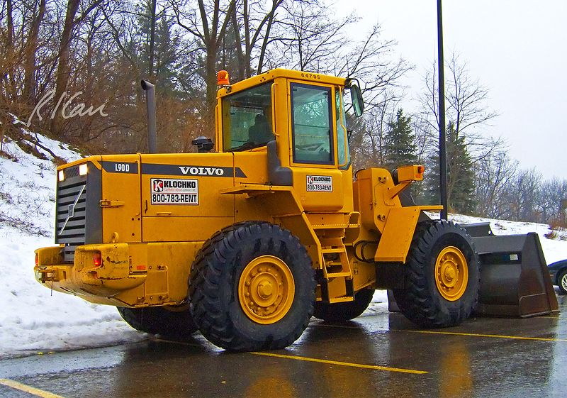Earthmoving construction: Volvo L90D 160 hp wheeled tractor front-end loader, parked at the side of a parking lot while the operator has a 2:00 PM afternoon snooze, waiting for some action. University of Michigan, Ann Arbor, February 2005.