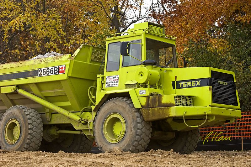 Earthmoving construction: Terex 2566B 6x6 drive end dump articulated off-road hauler moves stone for rip rap. Sams Club, Ann Arbor, 2004.