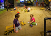 Earthmoving construction: Young constructors test their building skills at earthmoving simulation station at annual Science of Big Machines exhibit by the northern Ohio construction industry at COSI, the Center for Science and Industry, Toledo, Ohio, June 2006.