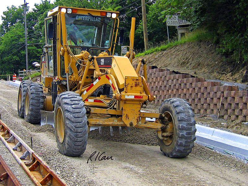 Caterpillar 2447 motor grader grading gravel for pavement base construction. Depot Street, Ann Arbor, 2004.