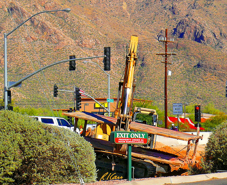 Trench construction/safety: Caterpillar 330CL backhoe/excavator picks up trench shield out of trench and sets it down in horizontal position suitable for it to be picked and transported by forklift. Tucson, Arizona November 2006.