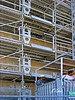 Scaffold construction safety: Automatically operating safety gates and thresholds at each scaffold level provide safe, efficient vertical transportation for construction workers and materials. Marseilles, France, 2002.