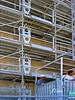 Construction scaffold: Automatically operating safety gates and thresholds at each scaffold level for construction worker elevator on the Cathedral de la Major in Marseilles, France.