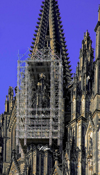Construction scaffold/platform: Scaffold near top of cathedral tower. for cleaning and rehabilitation, supported by cathedral itself. Cologne, Germany August 2006.