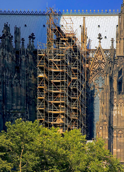 Construction scaffold/platform: Scaffold on portion of east side of cathedral for cleaning and rehabilitation. Cologne, Germany August 2006.