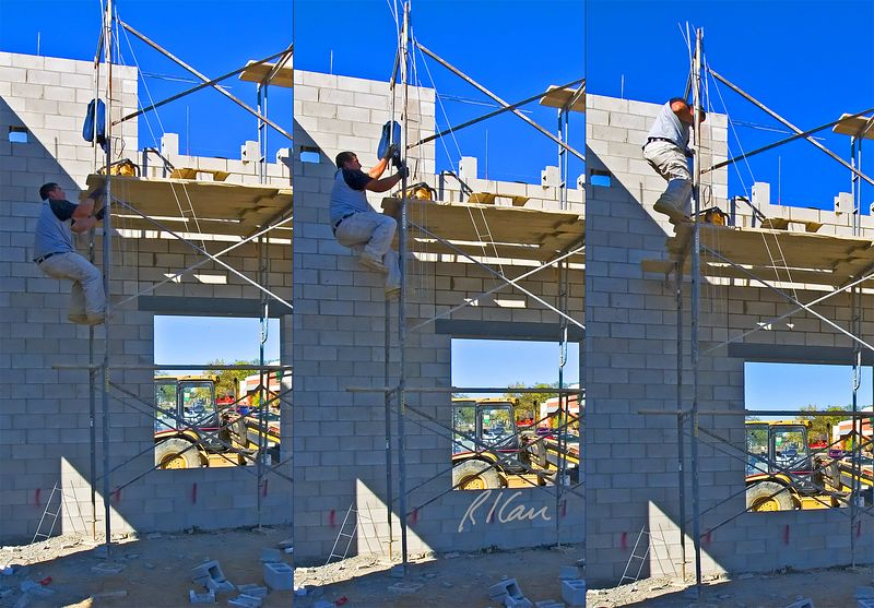 "Construction safety, fall hazard: Worker climbs built in ladder of welded tubular scaffold. Two positive safety factors: (1) vertical support extends above top platform, which allows worker to continue climbing vertically until reaching the platform with his feet to easily step onto the platform (instead of scrambling over the edge if the extension is not present). (2) Worker carries no tools in his hands, so he has full use of both hands and feet to safely climb ladder. Tools and light materials can easily be pulled up with a light rope once worker is standing on platform. A significant unsafe factor is the scaffold built in ladder ascends 6'-4"" with 4 steps = 19"" per step, which has distance between steps greater than 16 3/4"" allowed by OSHA standards. Ann Arbor, 2004."