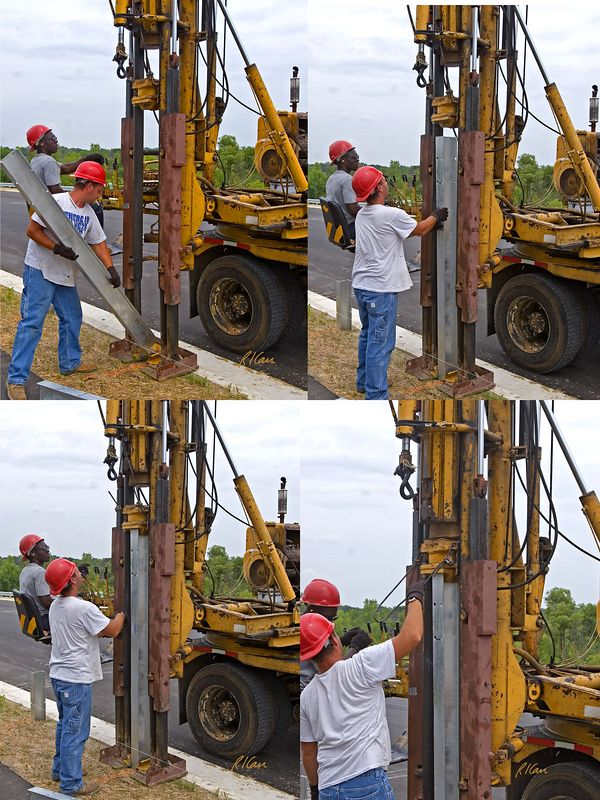 Road and fence construction: Truck mounted, highly specialized drop-hammer pile/post driver drives galvanized steel wide flange sections into ground to provide support for vehicle guardrails. The post is inserted into the drop-hammer guides/leads, and the top is fitted/attached to the cap that receives the beating from the drop-hammer. Operator uses control levers to initiate lift of drop-hammer by cable and then its drop onto post/pile cap. Dixboro Bridge construction, Ann Arbor, Michigan, August 2005.