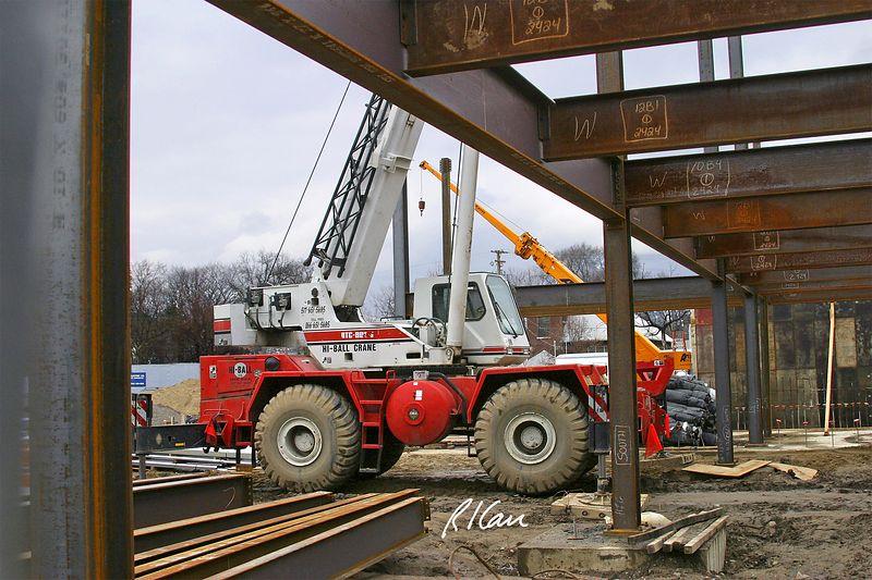 Structural steel construction: Link-Belt wheel mounted RTC rough terrain crane erects steel in construction of YMCA, Ann Arbor, 2004