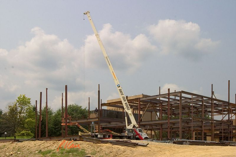 Structural steel construction: Terex BT4700 telescopic boom truck mounted crane erecting structural steel. Biomedical Engineering, North Campus, University of Michigan, Ann Arbor, 2004.