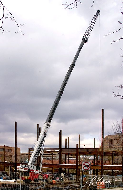 Structural steel construction: Link-Belt wheel mounted RTC rough terrain crane erects steel in construction of YMCA, Ann Arbor, 2004