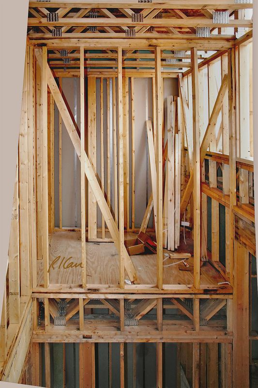 wood frame construction two stories of dimension wood framing shows studs at lower level - Wood Frame Construction