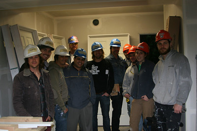 The members of Switchfoot with the Habitat EKC construction team. L to R: Tim Foreman, Chad Butler, Jerome Fontamillas, Habitat Homeowner Javier Berrios, Construction Supervisor Mike Hammerquist (background), Jon Foreman, Andrew Shirley, AmeriCorps member Jason Lanzillo, AmeriCorps member Martin Sostoi, AmeriCorps member Allyson Goldstein, AmeriCorps member Jon Poyner