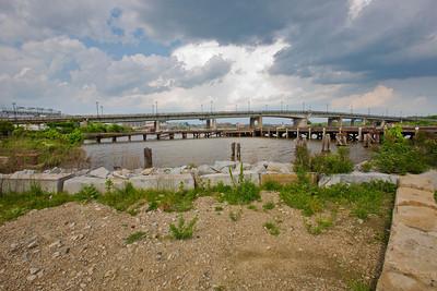 "Latitude 38º 52' 5.491"" ; Longtitude -77º 0' 28.969 View of Bridge facing East from DC Helipad"