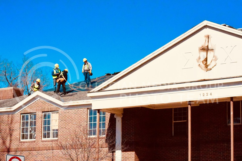 Construction workers roofing the Sigma Chi Fraternity during huge renovation.  <br /> (Skylar Stephens | 3.2.18 | Collegian Media Group)