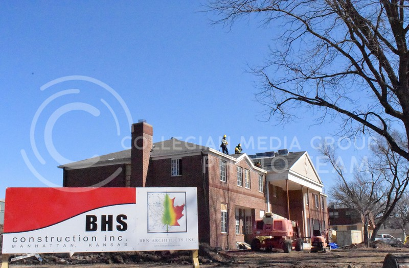 Construction workers roofing the Sigma Chi Fraternity during huge remodel.  (Skylar Stephens | 3.2.18 | Collegian Media Group)