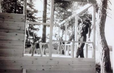 Charles Stone building cabin #102 in spring, 1946