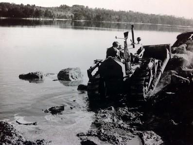 Bulldozing shoreline near cabin #108, early 1950's