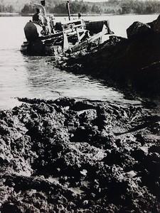 Bulldozing shoreline by cabin #108, early 1950's