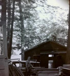 Demolition of original Joanna's cabin #5, Ralph in foreground, 1965