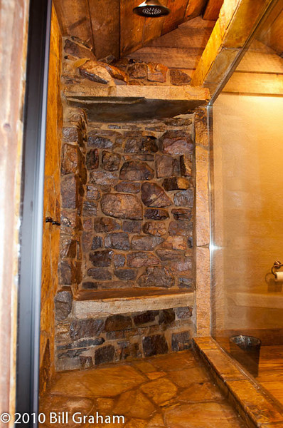 My favorite detail in the whole house, the master shower. Yes, Virginia, it's all stone and there's a shower outlet above the shelf over the bench that you can turn on and make your own personal waterfall...