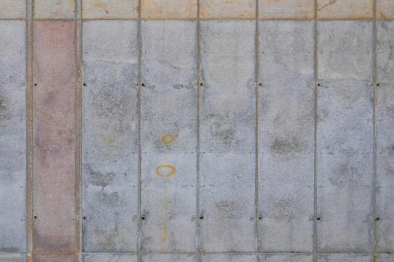 A concrete foundation wall after the forms are removed. The lines are created where there are joints in the formwork.