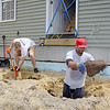 The crew working on the Habitat For Humanity house on Oakland Street in Fitchburg on Thursday was from Exit New Options Real-estate from Leominster. Members of that crew Locke Haman and Derek Johnson work on some holes' for the front stairs around noon. SENTINEL & ENTERPRISE/JOHN LOVE