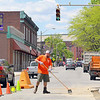 Road work is going on all over the City of Fitchburg. DPW employee Mario Orsini sweeps up the dirt as he work on a road project on Main Street where Oliver Street crosses over Main. SENTINEL & ENTERPRISE/JOHN LOVE