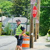 Road work is going on all over the City of Fitchburg. Officer Todd Deacon directs traffic around Cedar Street wher it meets Pearl Street because of road work closing it off on Wednesday afternoon. SENTINEL & ENTERPRISE/JOHN LOVE