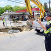 Road work is going on all over the City of Fitchburg. Officer Shawn Walker directs traffic at the work sight on Lunenburg Street near the corner of Lincoln Street. SENTINEL & ENTERPRISE/JOHN LOVE