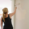41 Oakland Street in Fitchburg, a new home being constructed by the efforts of Habitat for Humanity. Krystal Hastings, of Aubuchon Hardware, paints a wall in the home on Monday afternoon. SENTINEL & ENTERPRISE / Ashley Green